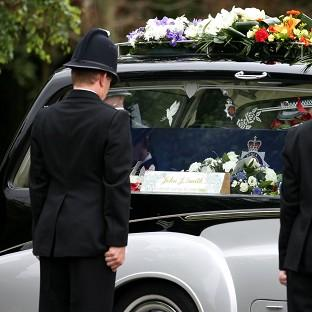 The funeral cortege of Pc Ian Dibell, who was shot dead as he tried to stop a gunman, arrives at Weeley Crematorium