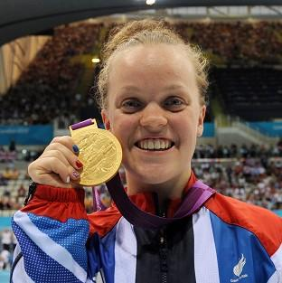Great Britain's Eleanor Simmonds celebrates with her Gold Medal after winning the Women's 200m IM SM6