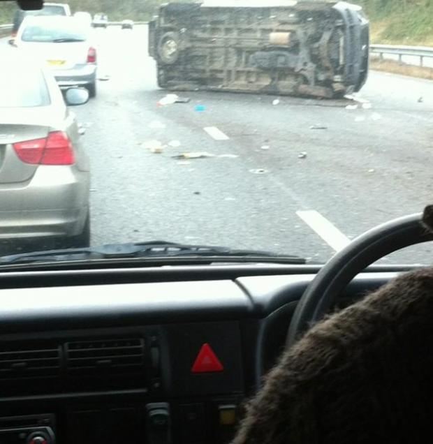 A flipped car on the M5.