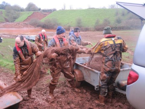 Environment Agency officers and volunteers from Tiverton Angling Club pack away nets after an operation to rescue trapped fish from a lagoon near the site of the collapsed Grand Western Canal near Halberton