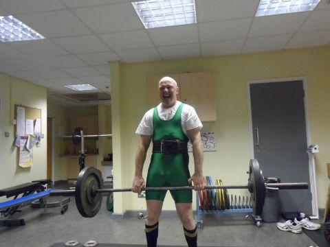Mid Devon Star: Gary attempting punishing finger lifts during his record-breaking weightlifting challenge in aid of charity
