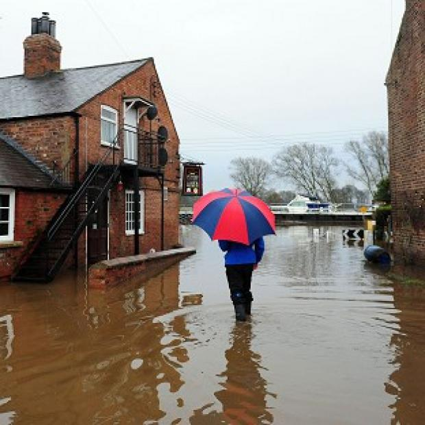 Total rainfall for 2012 was just millimetres shy of the record set in 2000 - and warnings over more flooding have been issued