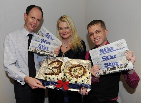 Editor Alex Cameron, advertising manager Sharon Mitchell and retail representative Mike Bird are pictured with a specially-prepared cake to mark the occasion