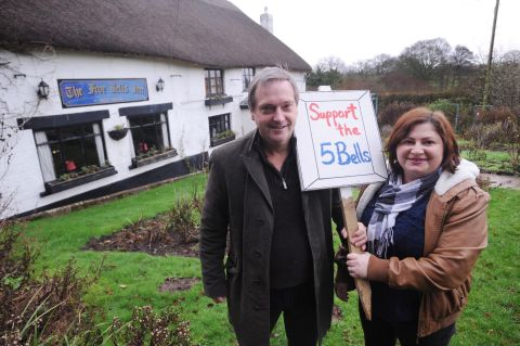Clive and Val Birch outside the Five Bells Inn in Clyst Hydon, near Cullompton, which they have launched a campaign to keep in business