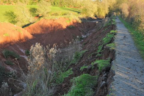 A deep gorge was carved in the raised embankment near Halberton, Tiverton, when the canal burst its banks during torrential rains in November