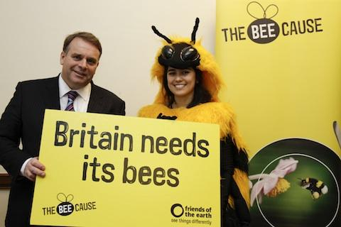 Neil Parish with a campaigner from Friends of the Earth, which visited MPs in Westminster to highlight the worrying decline of British bees