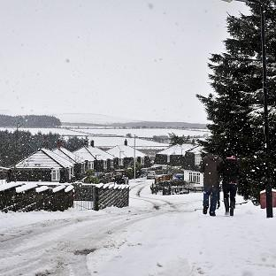 A street in Pricetown, Dartmoor, as snow starts to fall