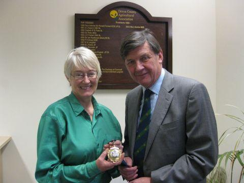 Mary Quicke, the outgoing president of the Devon County Agricultural Association, presents the chain of office to newly elected president the Hon George Lopes