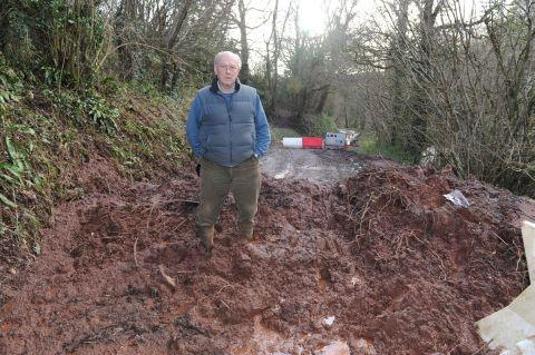 Chris Prentis standing on the pile of mud dumped near his Mid Devon home by Devon County Council contractors