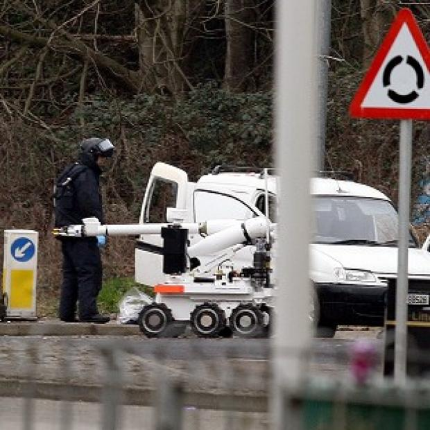 Police examine a van on the outskirts of Londonderry
