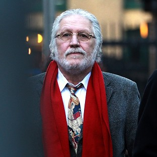 Former Radio 1 DJ Dave Lee Travis arrives for a pre-trial hearing at Southwark Crown Court in London where he faces sex charges