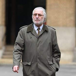 Mid Devon Star: Former DJ Dave Lee Travis arrives at London's Southwark Crown Court, where he is accused of a series of indecent assaults and one sexual assault