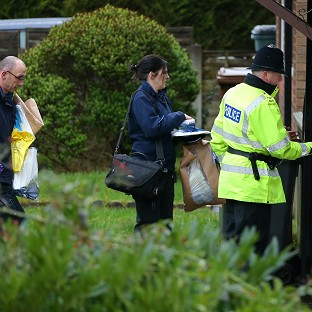 Police forensic officers arrive at a house in Emily Street, Blackburn, after a baby girl died when she was mauled by a pet dog