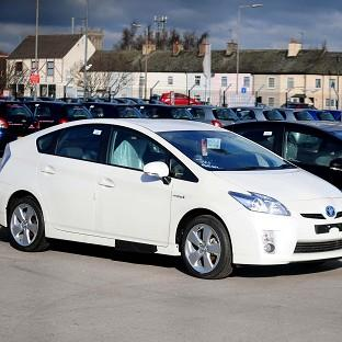 Toyota is recalling nearly 31,000 Prius hybrids over a glitch that makes the vehicle stop
