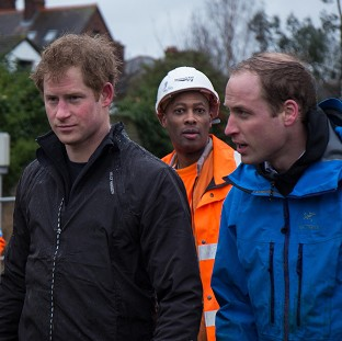 William and Harry help flooded town