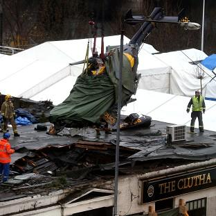 The wreckage of the police Eurocopter is lifted from the Clutha Vaults in Glasgow following the crash