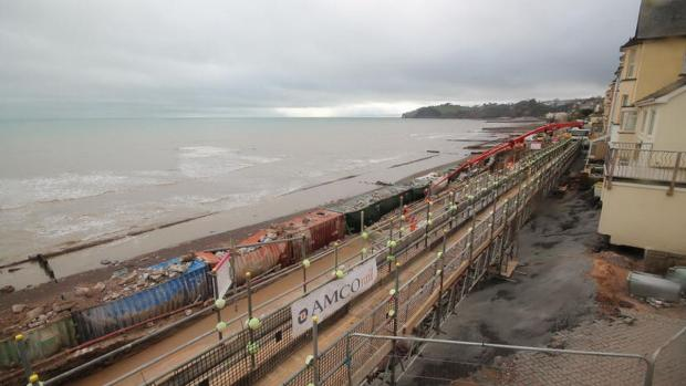 Firefighters pump water to force controlled landslip at Dawlish rail damage site