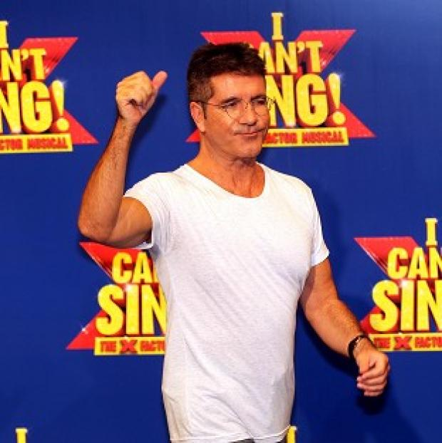 Mid Devon Star: Simon Cowell at the launch of the X Factor Musical 'I Cant sing' which has been hit by a technical glitch