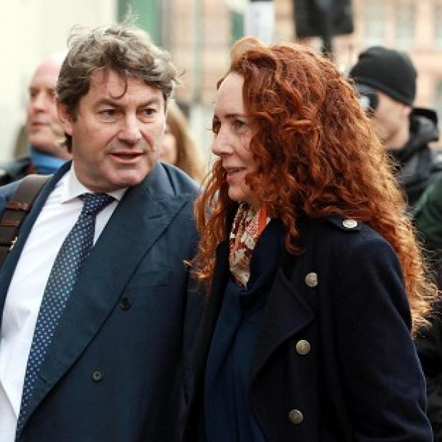 Mid Devon Star: Former News International chief executive Rebekah Brooks and her husband Charlie Brooks arrive at the Old Bailey