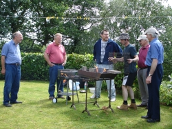 How many men does it take to light a barbecue?