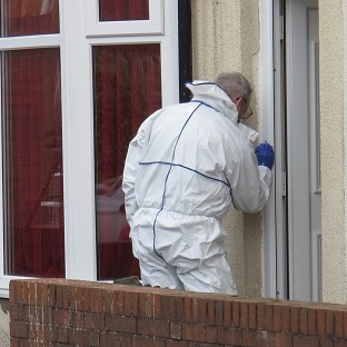 Forensics officers outside an address in Birmingham where a man was arrested after three people, including two teenage girls, were stabbed