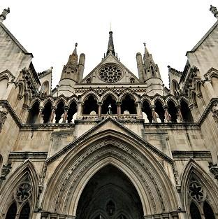 A High Court judge has praised a woman with drink and drug problems who agreed an adoption plan for her young