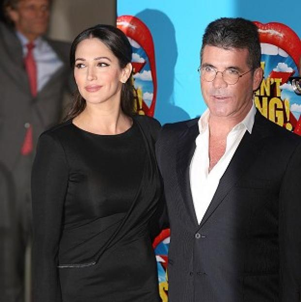 Mid Devon Star: Lauren Silverman and Simon Cowell attending the opening night of I Can't Sing! The X Factor Musical