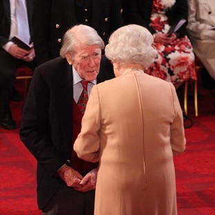 Raymond Roberts receives his Member of the British Empire medal from the Queen during an investiture ceremony at Buckingham Palace in February last year.