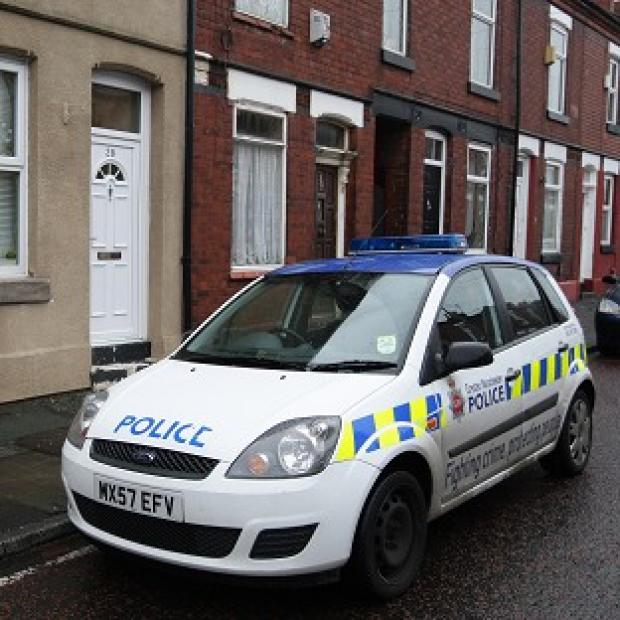 Mid Devon Star: A police car outside the home of nurse Victorino Chua in Stockport when he was previously arrested