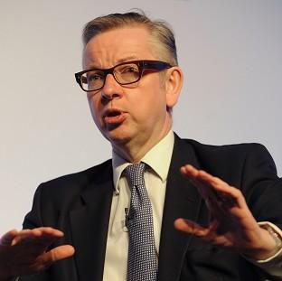 The NUT has attacked Michael Gove over spending on a free school