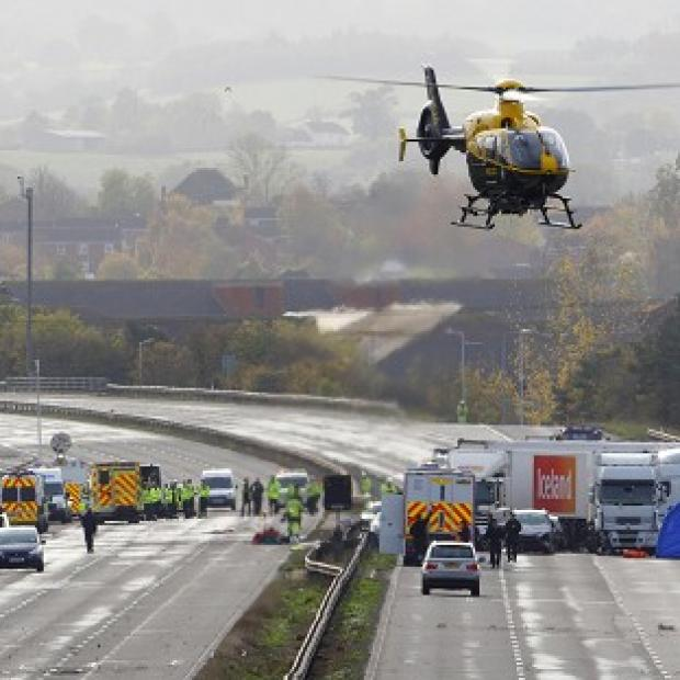 Mid Devon Star: Emergency services work at the scene on the M5 motorway close to Taunton following the pile-up