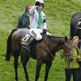Mid Devon Star: Jockey Leighton Aspell celebrates winning the Crabbies Grand National on Pineau De Re
