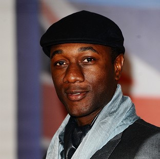 American soul singer Aloe Blacc dropped to number three in the singles chart