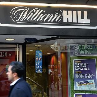 More than 100 William Hill betting shops are to close after a surprise increase in gaming machine tax in the Budget