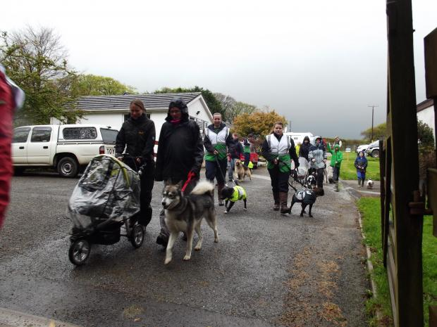 Walkers bravely battle the elements for charity fundraiser