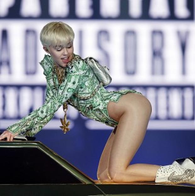 Mid Devon Star: Miley Cyrus performs in concert at the O2 Arena, London, on the UK leg of her Bangerz tour.