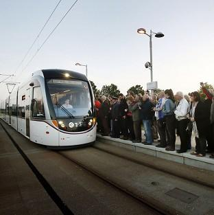 Mid Devon Star: The first paying passengers wait to board a tram at the Gyle shopping centre in Edinburgh