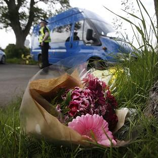 Mid Devon Star: Floral tributes near the scene at Little Swinton, near Coldstream, where three people were killed after a car lost control at the Jim Clark Rally in the Scottish Borders yesterday.