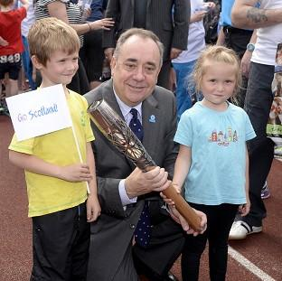 Scotland's First Minister Alex Salmond with Craig Burns (aged seven) and Marilee Burns (aged fiv
