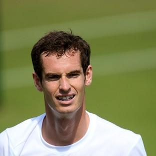 Mid Devon Star: Andy Murray smiles during his practice session at Wimbledon