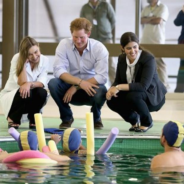 Mid Devon Star: Prince Harry meets patients in the Rede Sarah Hospital for Nerological Rehabilitation injuries during his visit to the hospital in Brasilia