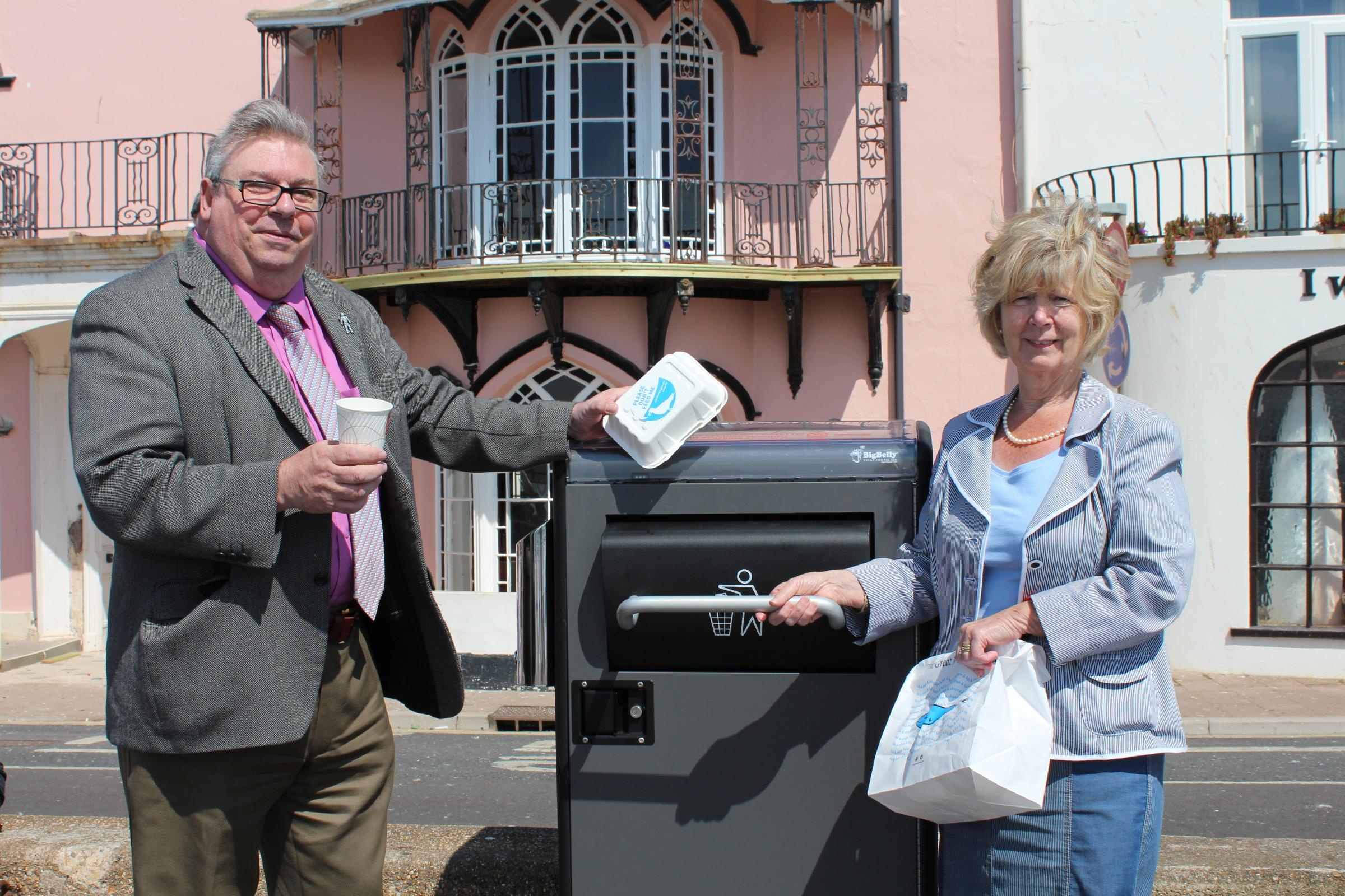 Trying out one of Budleigh Salterton's new bins – Ward Member Councillor Alan Dent (left) and Ward Member and Deputy Cabinet Member for Environment Tom Wright.