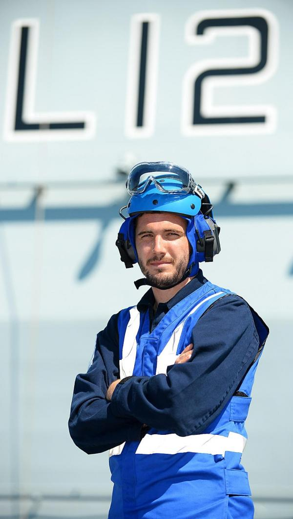 Royal Navy sailor sails with aircraft carrier