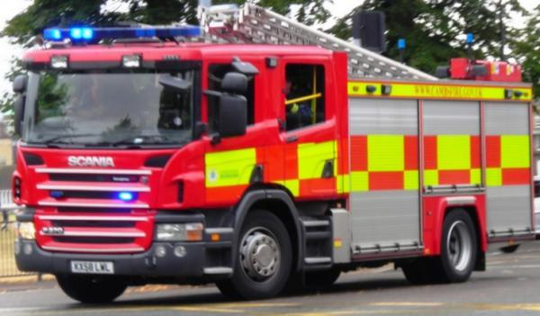 Three people in hospital after fire at Axminster Carpets