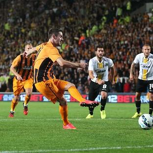 Robbie Brady, second from left, scores Hul