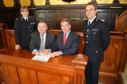 The agreement being signed by (from left to right) Chief Constable Debbie Simpson, PCC Martyn Underhill, PCC Tony Hogg and Chief Constable Shaun Sawyer